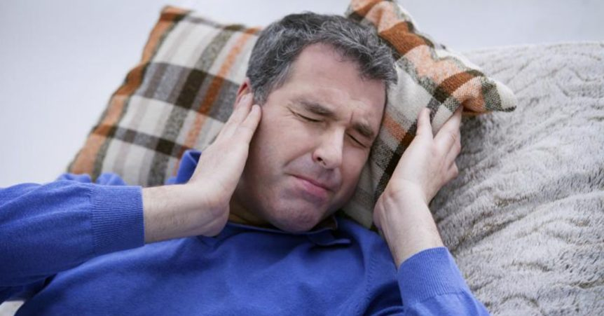 Man suffering Tinnitus